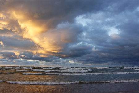 bend over: Storm Clouds Over a Lake Huron Beach at Sunset - Grand Bend, Ontario