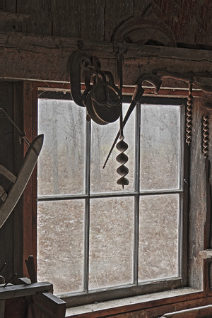 blacksmith shop: Antique Tools Hanging by the Window of an Old Blacksmith Shop - Lambton County, Ontario