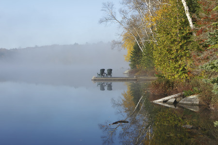 muskoka: Autumn Shoreline and Dock on a Misty Morning in the Haliburton Highlands - Ontario, Canada