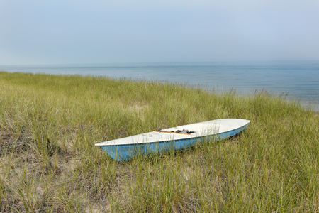 pinery: Small Sailboat Sitting in Dune Grass Next to Lake Huron - Grand Bend, Ontario, Canada