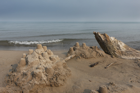 pinery: Sand Castle and Driftwood on a Lake Huron Beach - Grand Bend, Ontario, Canada Stock Photo