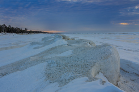 frozen lake: Natural Ice Sculptures on a Frozen Lake Huron at Sunset - Grand Bend, Ontario, Canada Stock Photo