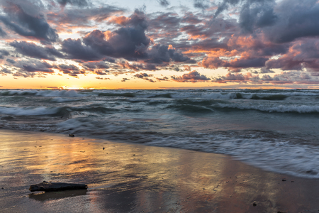 storm clouds: Storm Clouds Over a Lake Huron Beach at Sunset - Grand Bend, Ontario, Canada