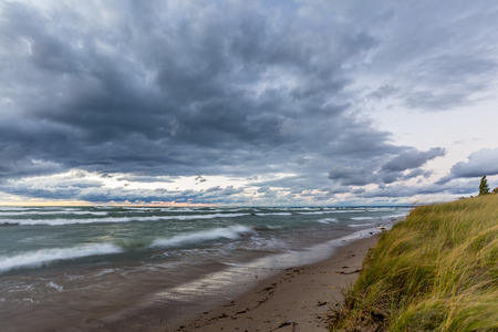 bend over: Storm Clouds Over a Lake Huron Beach at Sunset - Grand Bend, Ontario, Canada