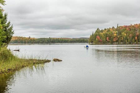 algonquin park: Canoeing on an Ontario Lake in Autumn - Algonquin Park, Ontario, Canada Stock Photo