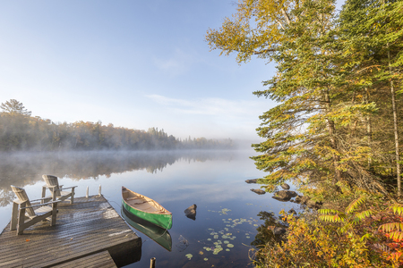 Canoe Tied to a Dock at Dawn - Haliburton, Ontario, Canada