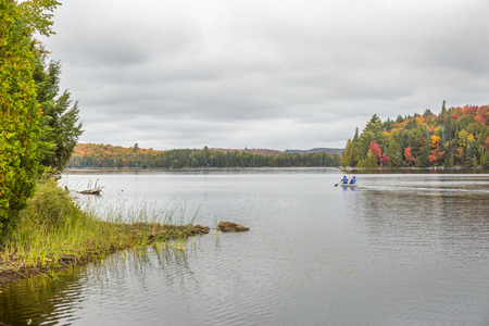 Canoeing on a Lake in Autumn - Algonquin Provincial Park, Ontario, Canada
