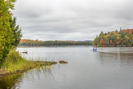 muskoka: Canoeing on a Lake in Autumn - Algonquin Provincial Park, Ontario, Canada
