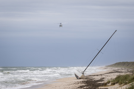 cape canaveral: Helicopter Flying Over a Stranded Sailboat - Cape Canaveral National Seashore, Merritt Island, Florida