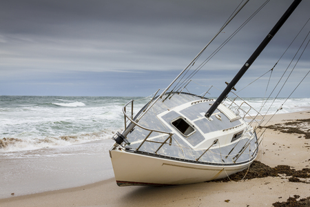 cape canaveral: Sailboat Grounded on a Sandy Beach - Cape Canaveral National Seashore, Merritt Island, Florida Stock Photo