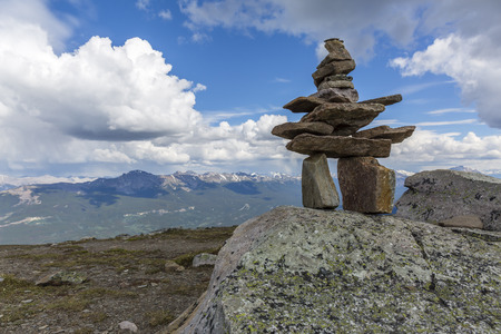 An Inukshuk stands sentinel in Jasper National Park - Alberta, Canada