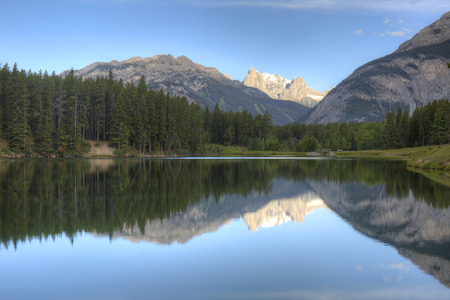 boreal: Mountains and boreal forest reflect on the surface of Johnson Lake - Banff National Park, Alberta, Canada