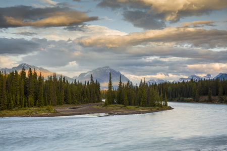 rocky mountains: Athabasca River at sunset with Rocky Mountains in background - Jasper National Park, Alberta, Canada Stock Photo