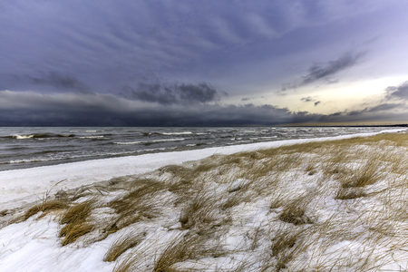 Snow and ice begin to build up along a Lake Huron shoreline in December - Grand Bend, Ontario, Canada