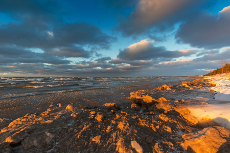 A late afternoon sun illuminates the Lake Huron shoreline in December - Grand Bend, Ontario, Canada Stock Photo