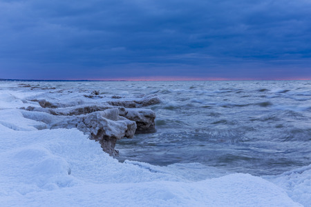 Lake Huron Shoreline at Twilight in Winter - Grand Bend, Ontario Stock Photo