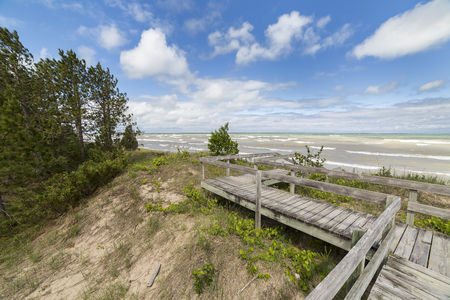 A boardwalk traverses a fragile freshwater sand dune ecosystem on the shore of Lake Huron - Pinery Provincial Park, Ontario, Canada