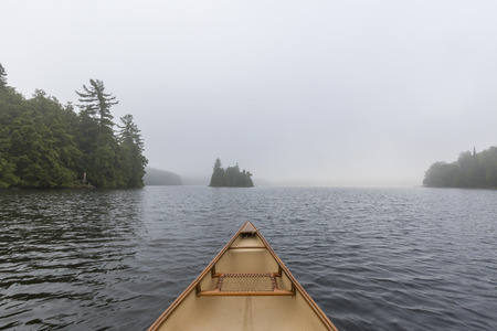 Canoe bow on a misty morning on a lake in Ontario, Canada Stockfoto