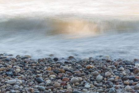 Waves rushing over stones on a Lake Huron beach - Pinery Provincial Park, Ontario, Canada