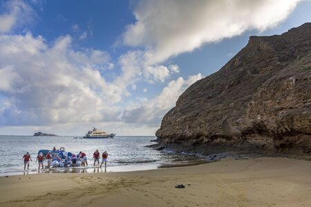 Tour Group landing on San Cristobal Island - Galapagos Archipelago