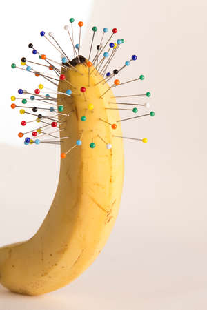 sexual intercourse: Urinary problems: pins and banana Stock Photo