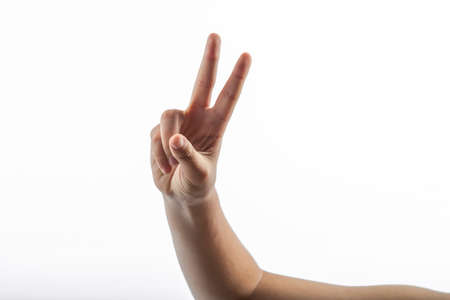 middlefinger: Young hands makes a gesture: victory sign with two fingers Stock Photo