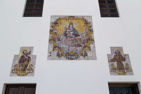ionio: Paintings of the Blessed Virgin Mary on the facade of Church La Puritate  the old town of Gallipoli (Le) in the southern of Italy Editorial