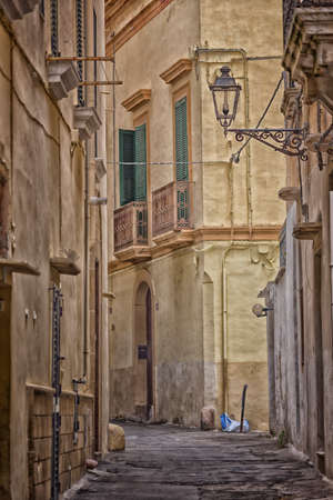 Old alley  in the old town of Gallipoli (Le)) in the southern of Italy photo