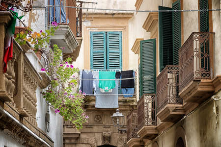 Hanging clothes in Old alley  in the old town of Gallipoli (Le)) in the southern of Italy photo