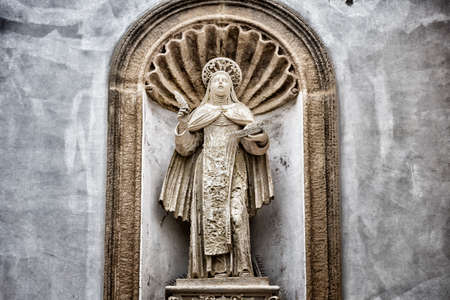 St. Therese of Lisieux statue on the facade of the church and convent of Carmelitane Scalze  in the old town of Gallipoli (Le) photo