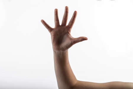 middlefinger: Young hands makes a gesture: sign of 5 fingers