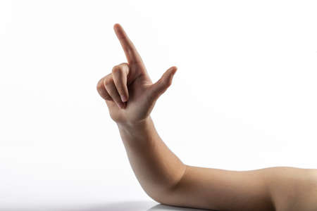 middlefinger: Young hands makes a gesture: number two sign or gun sign