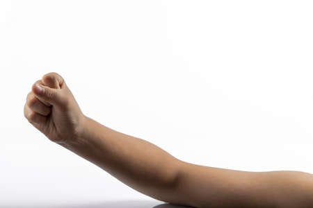 middlefinger: Young hands makes a gesture in rock-paper-scissors game: rock sign