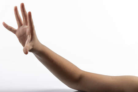 middlefinger: Young hands makes a gesture in rock-paper-scissors game: paper sign