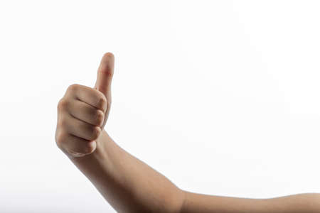 middlefinger: Young hands make a hitchhiking gesture