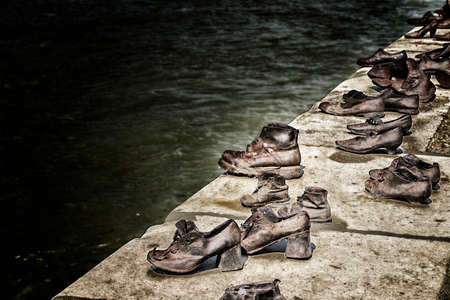 honouring: Iron shoes on the Pest side of the danube honouring the jews killed during the world wide war II