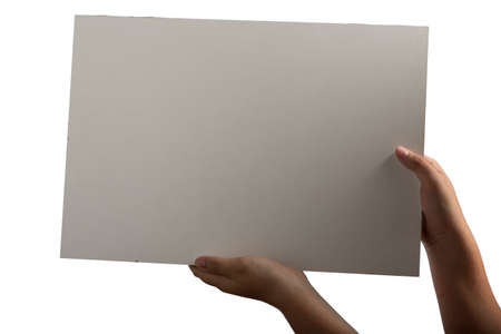 supported: A light white plastic laminate square blank sign supported by young hands on light background