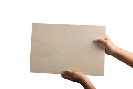 supported: A light colour plywood square blank sign supported by young hands on light background