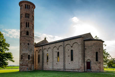 cylindrical: Medieval countryside church of Campanile with romanesque cylindrical bell tower, located in the village of Santa Maria in Fabriago in Emilia Romagna region in northern Italy Stock Photo