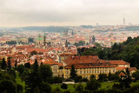 Gloomy day of rain and fog over the red roofs of Prague in the Czech Republic in Central Europe. photo