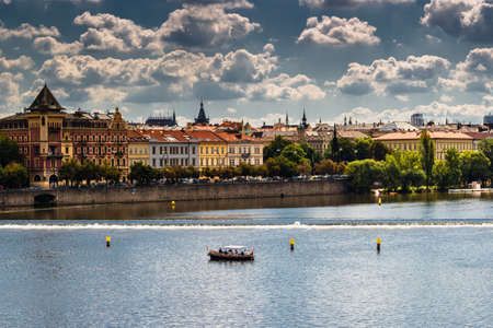 View from Charles Bridge in Prague: Vltava river,\ Architecture details, tower, church, statue and sculpture of