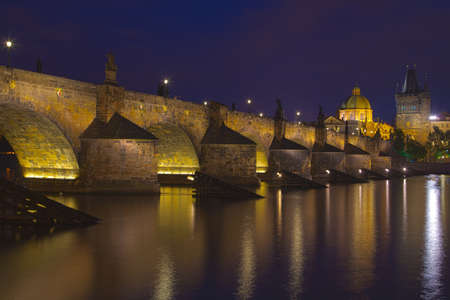 A night view of the river Vltava and Karlovy Most, the Charles Bridge in Prague