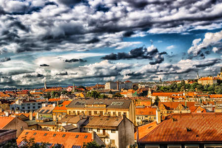 Scenic view of the historical center of Prague: houses, buildings, palaces, landmarks of old town with the characteristic and picturesque red rooftops and multi-coloured walls. photo