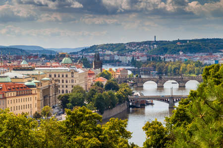 vltava: Scenic view of the Vltava river and of the historical center of Prague: houses, buildings