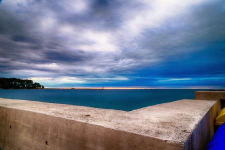 bulkhead: Sunset on prefabricated breakwater Stock Photo