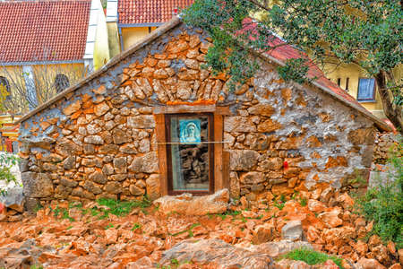 apparition: Picture of the Blessed Virgin Mary on Mount Podbrdo, the  Apparition hill overlooking the village of Medjugorje in Bosnia ed Erzegovina Stock Photo