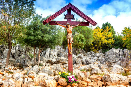 Wooden Crucifixion Cross on Mount Podbrdo, the  Apparition hill overlooking the village of Medjugorje in Bosnia ed Erzegovina