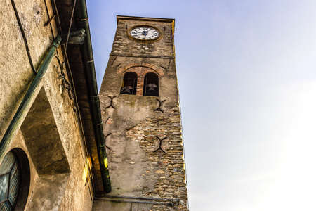 country church: Medieval brickwall steeple of a country church in Emilia Romagna in the Northern Italy countryside. Clock at 17:40