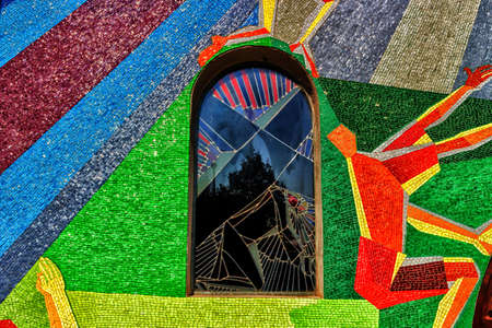 viacrucis: Window with decal in Medugorje: fall of Jesus Christ in Station of the Cross, Via Crucis.  Mosaic wall  Stock Photo