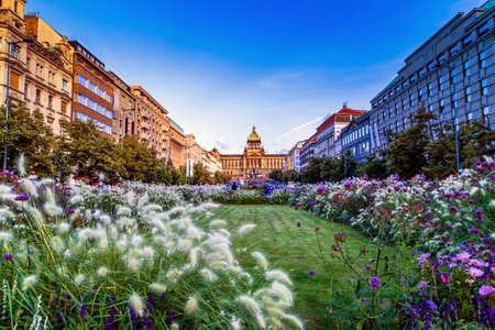 Buildings  and houses in the historical center of Prague. Wenceslas square in Prague in Central Europe: the equestrian statue of Saint Wenceslas and the Neorenaissance National Museum Banco de Imagens